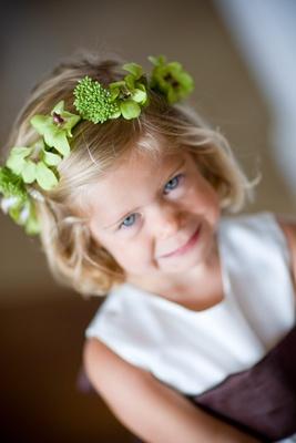 Flower girl wearing green orchid flower crown