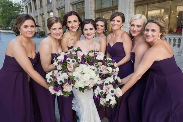 bride with bridesmaids purple bridesmaid dresses purple anemone rose flower bouquets