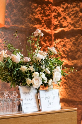 White flowers peony rose signature drinks share the love hashtag in frame on wood bar