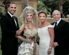 Bride in Madonna-inspired outfit with groom, mom, and dad