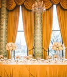 wedding reception head table tall drapes valances hotel wedding ballroom high low centerpieces