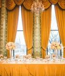 wedding reception head table tall drapes valances hotel wedding ballroom high low centerpieces