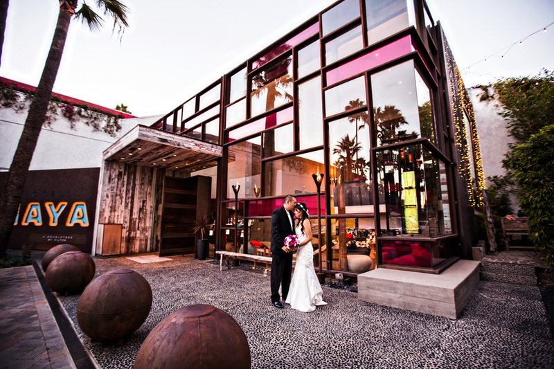 bride and groom in front of hotel maya courtyard with glass building in long beach