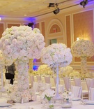 Joanna Krupa wedding reception with white flower centerpieces