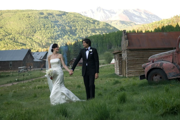 Bride and groom in mountain rustic retreat