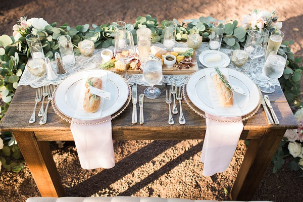 wooden sweetheart table place settings runner blush napkins rustic chic california winery wedding