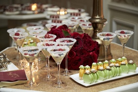 wedding dessert table macarons and pudding in cocktail glasses with sugar on the rim