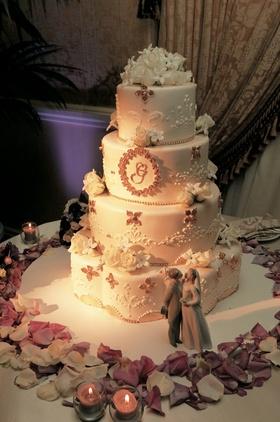 White wedding cake with purple embellishments