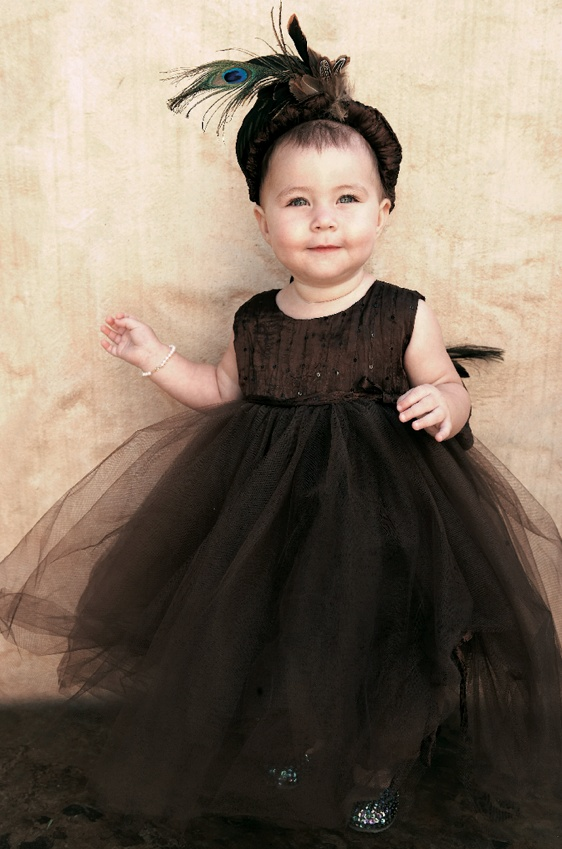Brown dress with headband and feathers