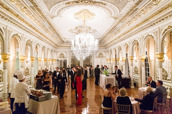 wedding reception mar-a-lago club white and gold ballroom chandelier hors d'oeuvres and appetizers