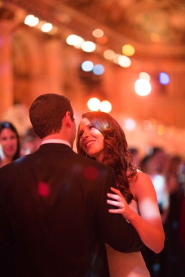 Bride stares lovingly into her husband groom's eyes at wedding reception The Plaza Hotel New York