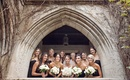 bride and bridesmaids in white and black with white and blush bouquets outside chicago church