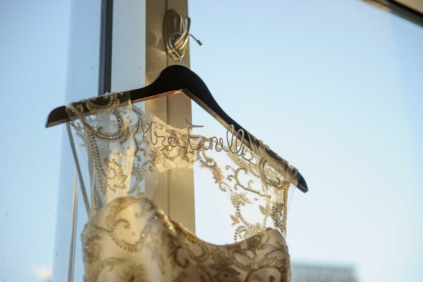custom dress hanger with bride's married name monique lhuillier keyhole back wedding dress