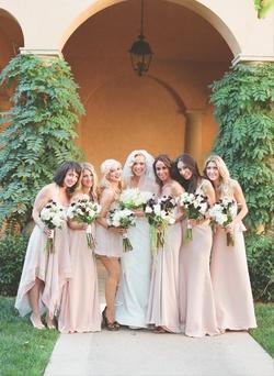 Simone Harouche in a Carolina Herrera gown, bridesmaids in pale pink dresses and Christina Aguilera