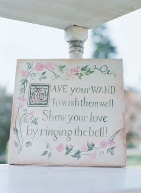 Shabby chic wedding sign for wand waving at ceremony in story book form