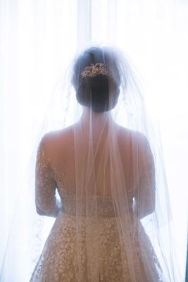 bride showing off back dress veil headpiece elegant up-do twigs and honey roman catholic wedding