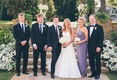 Young newlyweds pose with brothers and mother-of-the-bride