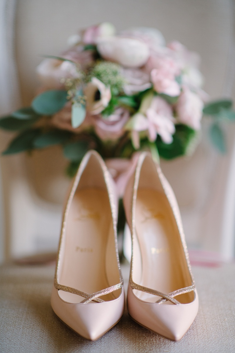 Bride's pink Louboutin pumps with rose gold details