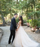 bride in blush monique lhuillier wedding dress and jeweled headband, groom in suit