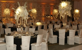Chameleon chairs around black wedding tables