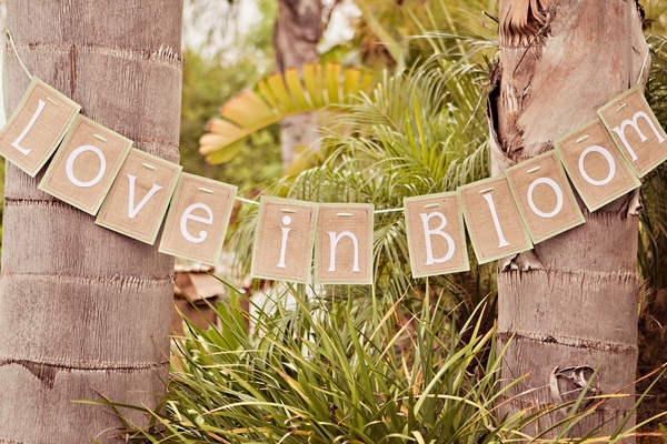 Bridal shower sign between palms
