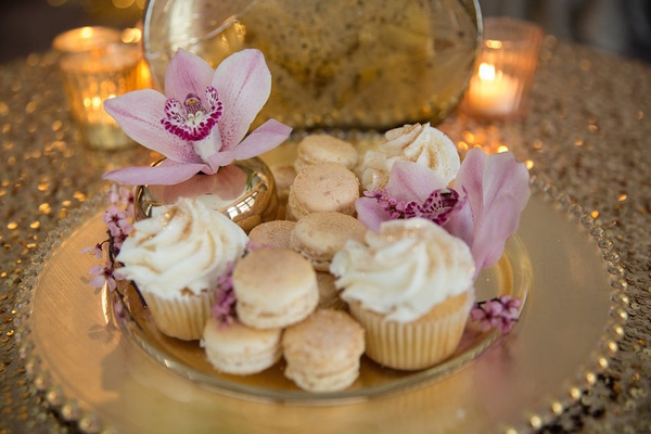 Gilded wedding dessert plate vanilla cupcakes, macarons, pink orchids