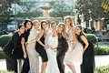 "bride in oscar de la renta ""snowflake"" mermaid gown with friends in their own dresses"