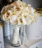 bridal bouquet with orchids, beige roses, pearl and brooch details
