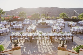 Reception tables around a fountain with mountain views