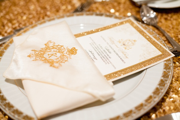 Glitter-rimmed menu card and embroidered napkin