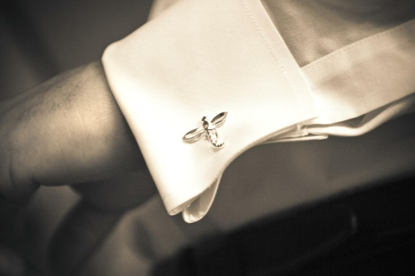 Black and white photo of dragonfly cufflink