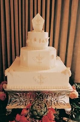 White wedding cake with fleur de lis design