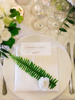 wedding reception place setting white linen napkin with green fern leaf and white flower custom menu
