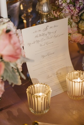 White menu card with calligraphy and gold lettering