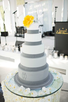 White and grey fondant cake with yellow flower cake topper orchid table display cake table