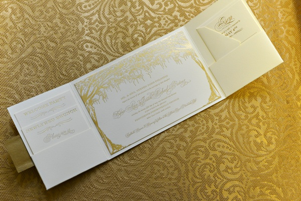 Wedding invitation with trees draped in moss stamped in gold