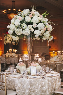 Wedding reception centerpiece with white and pink flowers