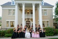 Bride with pink flower girls and black bridesmaid dresses
