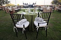 Wood chairs with white cushions and bride and groom signs