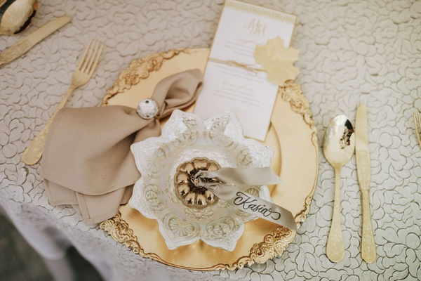 fall wedding ideas inspiration gold pumpkin on gold plate with gold flatware menu card
