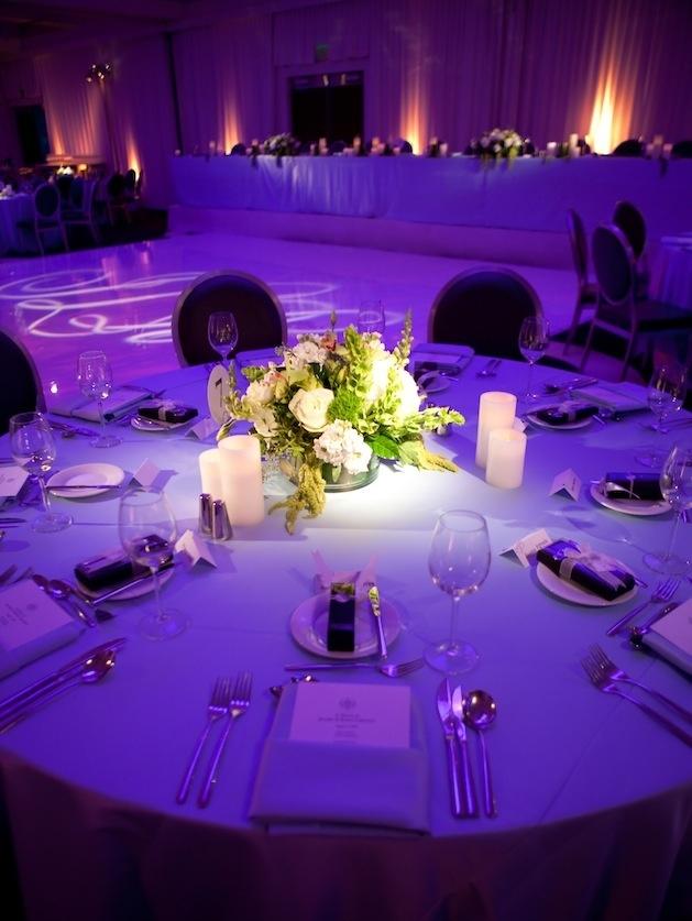 Bright purple lighting on wedding reception table