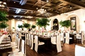 Monstera palm centerpieces at indoor beach wedding reception