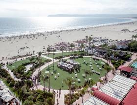 wedding ceremony on grass lawn at hotel del coronado overlooking ocean san diego wedding ideas