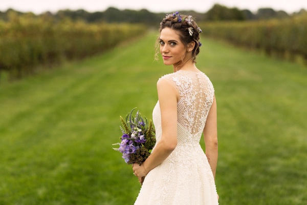 vineyard Lyndsy Fonseca actor in wedding dress embellishments on back purple flowers with florals