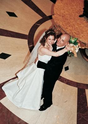 White bridal gown and black tuxedo