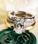 Wedding ring on monogram stamp wax seal green with oval solitaire engagement ring four prong