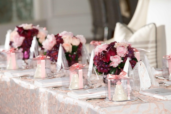 Pink and red floral arrangement at bridal shower