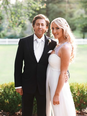Man in tuxedo and white tie and woman in wedding dress