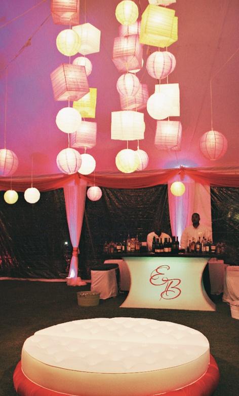 Monogrammed bar with round plush furniture