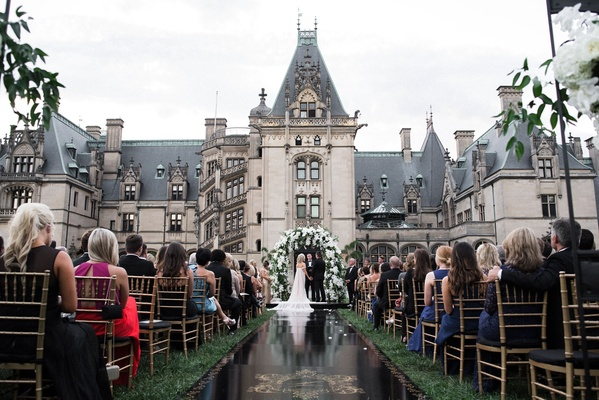Wedding ceremony at the Biltmore Estate in Asheville, North Carolina black aisle runner gold crest